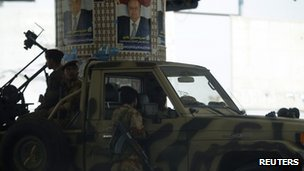 Army soldiers are positioned on a street near the Defence Ministry&quot;s compound in Sanaa 