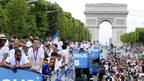 French athletes in Olympic victory parade on the Champs-Elysees in Paris (13 August)