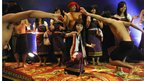 Mary Kom (C) performs a traditional Manipuri dance during a reception in her honour in New Delhi on 14 August 2012.