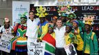 Medal winners Chad le Clos (3rd L) and Cameron van der Burgh pose with fans during the South African Olympic team arrival and press conference at OR Tambo International Airport