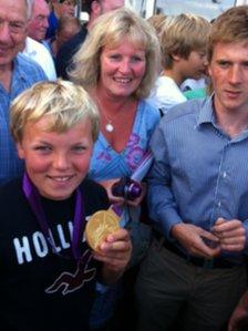 George Matcham, 12, wearing Ben Ainslie's medal