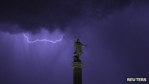 Lightning above the Christopher Columbus monument in Madrid