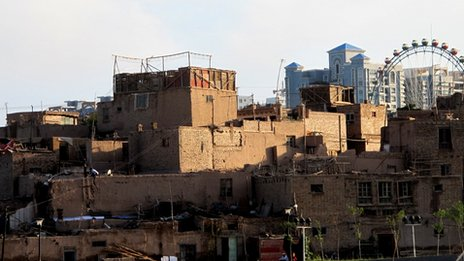 Houses in Kashgar's old city with the new apartment blocks in the background