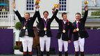 Nick Skelton, Ben Maher, Scott Brash and Peter Charles receiving their gold medals