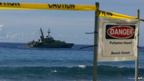 An Australian navy vessel sails past Christmas Island on 29 February 2012