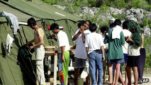 File image of men at asylum camp in Nauru on 21 September 2001