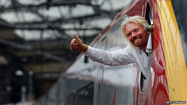 Richard Branson leaning out of the window of a Virgin Pendolino train