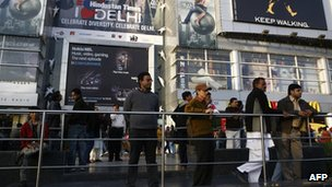 People outside a shopping mall in India
