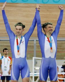 ATHENS, GREECE - SEPTEMBER 19: Ian Sharpe and Paul Hunter take the Bronze Medal after finishing third in the Mens Individual Pursuit Open(B1-3) Finals at the Olympic Velodrome within the Olympic Sports Complex in Athens, Greece. (Photo by Ker Robertson/Getty Images)
