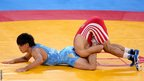 Ashraf Aliyev of Azerbaijan (right) competes with Sohsuke Takatani of Japan during their Men&#039;s Freestyle 74 kg Wrestling qualification bout