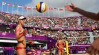 Sara Goller of Germany prepares to serve during the beach volleyball round of 16