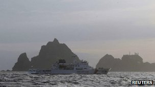 A South Korean coastguard vessel passes the Dokdo/Takeshima islands (file image)