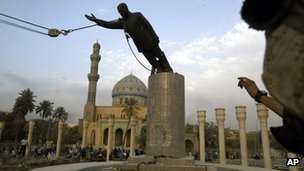 Saddam Hussein statue being pulled over
