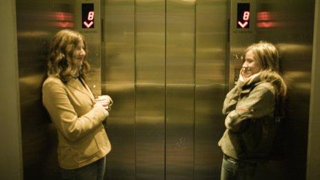Two women in a lift