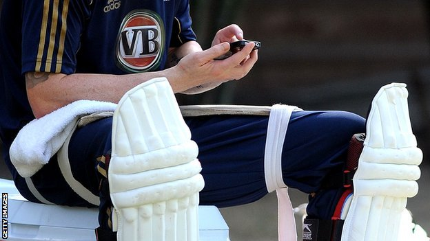 Cricketer using mobile phone
