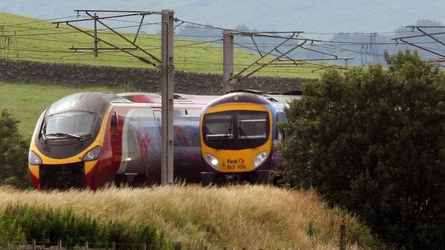 A Virgin train passes a FirstGroup train on the West Coast line
