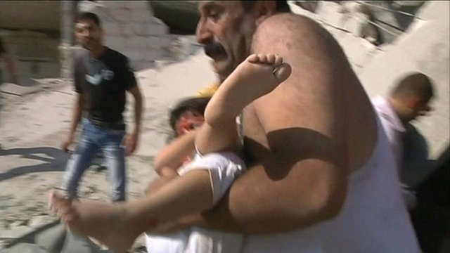 Man carrying injured child