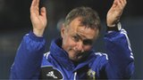 Michael O'Neill acknowledges the fans after the game