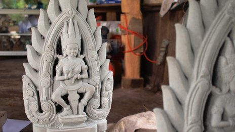 A restored sculpture at a workshop in Angkor
