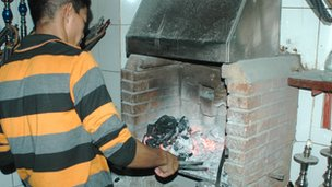 Preparing charcoal for shisha pipes
