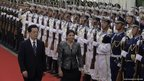 Costa Rica's President Laura Chinchilla inspects an honour guard