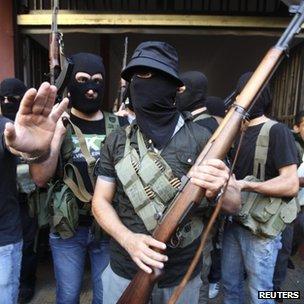 Masked gunmen from the Mekdad clan