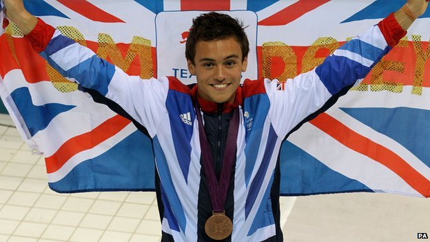 Tom Daley with Olympic medal
