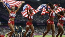 Allyson Felix, Carmelita Jeter, Tianna Madison and Bianca Knight (L-R) of the USA celebrate winning gold in the women's 4x100m relay final
