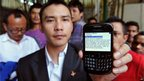 An Indian northeastern minority resident shows his mobile phone displaying a text message spreading rumours about their safety in the city, in Bangalore on 16 August, 2012.