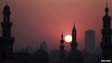 A view of mosques in Cairo as the sun sets