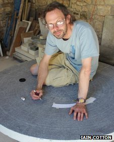 Artist Iain Cotton working on the Cotswold Way trail marker