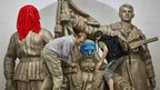 Pussy Riot supporters decorate a statue in an underground station in Moscow (17 Aug 2012)