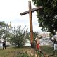An activist with feminist group Femen cuts down a cross in Kiev, Ukraine (17 Aug 2012)