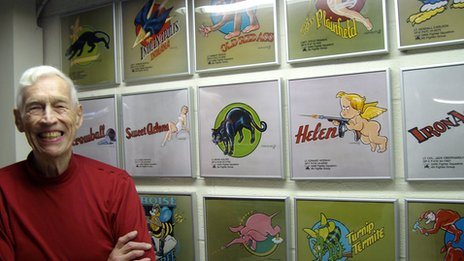 Don Allen in his Ohio basement with reproductions of his nose art images