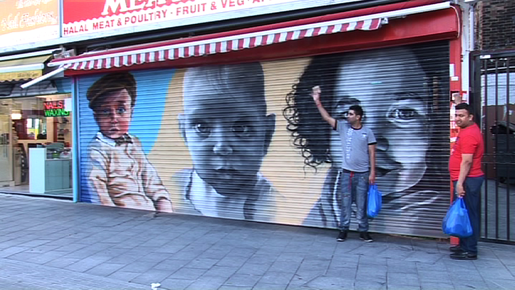Babies' faces painted on shops