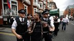 Police detain a supporter of Julian Assange for obstructing the highway outside the Ecuadorean Embassy in London