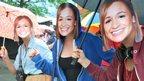 Three girls wearing Jess Ennis masks