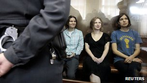 Members of the female Russian punk band Pussy Riot sit in court on 17 August 2012, when they were sentenced to two years in jail for an anti-Putin protest in a Moscow cathedral