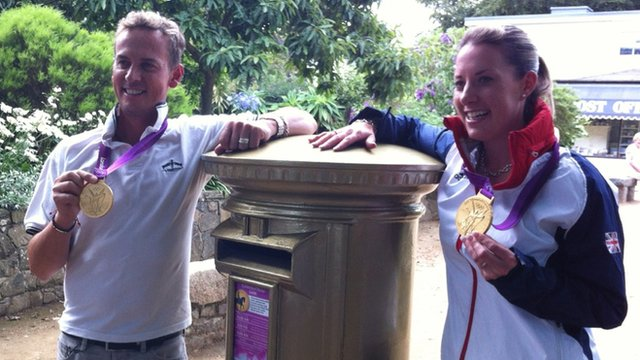 Gold medal Olympians Carl Hester and Charlotte Dujardin next to Sark's only postbox