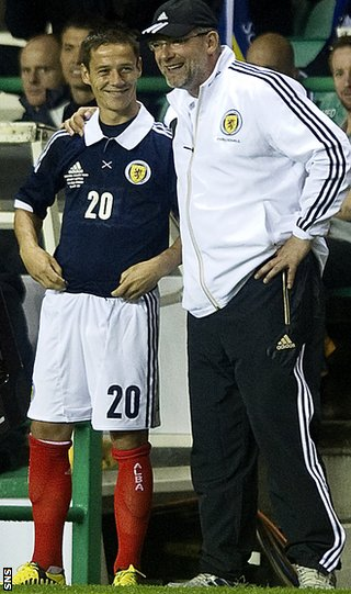 Ian Black and coach Craig Levein share a joke as he makes his Scotland debut