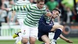 Celtic's Kris Commons (left) is stopped in his tracks by Stuart Kettlewell