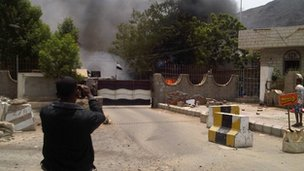 Smoke rises from the intelligence building in Aden, Yemen