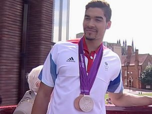 Louis Smith on open top bus