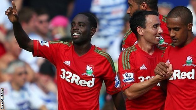 Nathan Dyer (left) celebrates Swansea's third goal with Leon Britton and Wayne Routledge