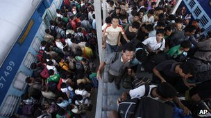 Indians get off a train originating in Bangalore in Gauhati, Assam's main city.