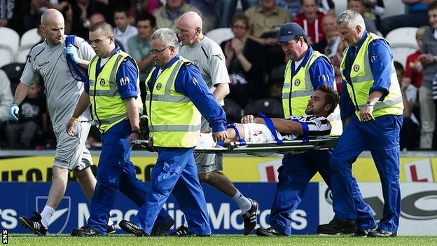St Mirren defender Darren McGregor is stretchered off injured during the defeat by Hibernian