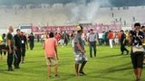 Etoile du Sahel fans invade the pitch during the 2-0 defeat by Esperance