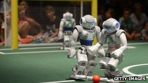 Robots play football at the Ideen Park fair on August 13, 2012 at the fair ground in Essen, western Germany.