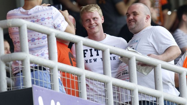 Gary Mackay-Steven (centre) was left to mingle with the United fans at Tannadice