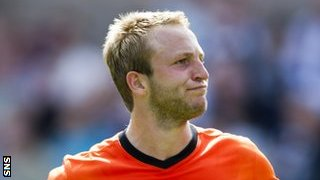Two-goal Johnny Russell celebrates against Dundee before being sent off
